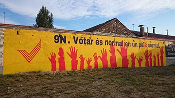 "Catalan billboard reads,""Voting is normal in a normal country."""