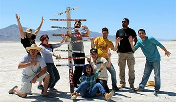 Members of the cast and crew take to the desert for filming.