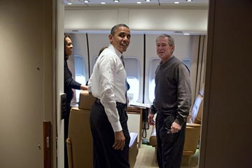 President Obama meets with former President George W. Bush on their way to South Africa in 2013. President Obama was known to regularly consult with President Bush throughout his two terms in office.