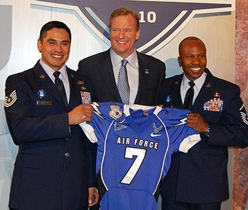 Two Air Force sergeants present NFL Commissioner Roger Goodell an Air Force jersey at the 2010 NFL Draft.