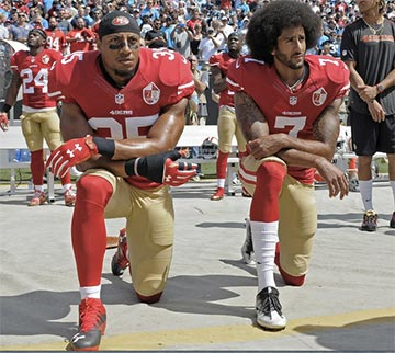 Trump called for kneeling football players to be fired. Editorial credit: Evan El-Amin / Shutterstock.com