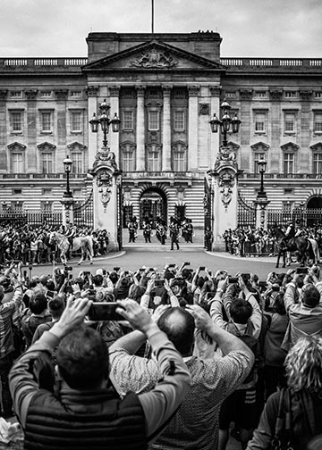 Crowds gather outside Buckingham Palace for the Changing of the Guard ceremony.