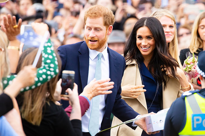 The Duke and Duchess of Sussex greet crowds while on a royal visit to Melbourne, Australia in 2018.